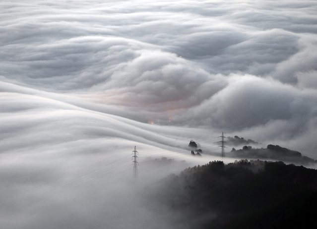A general view of a mountainous landscape in Pamplona covered in a thick blanket of smog on 23 Decem