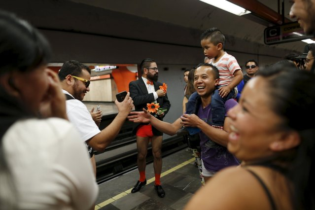 "A passenger not wearing pants dance waits for a subway train as others laugh during the ""No Pants Su"