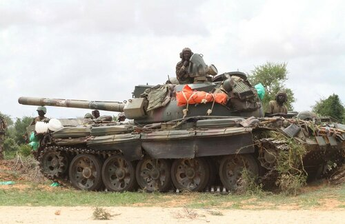 An AMISOM tank patrols after fighting between insurgents and government soldiers on the outskirts of Mogadishu