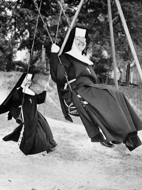 Nuns Swinging on Swing Set