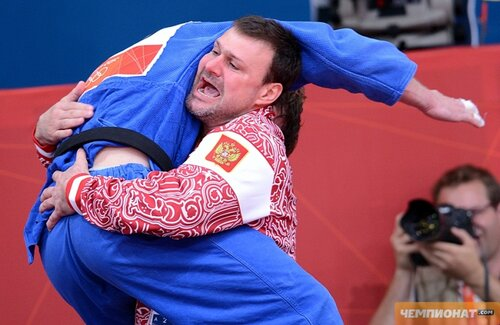 Russia's Ivan Nifontov celebrates with h