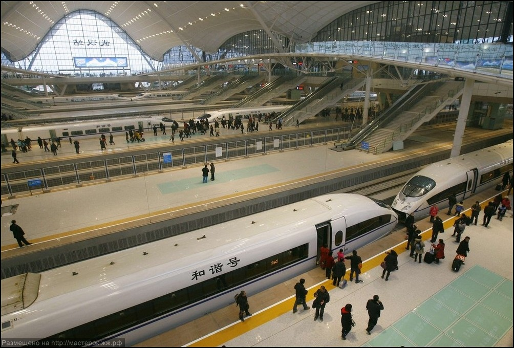 Travellers board a high-speed train which heads to Guangzhou in Wuhan
