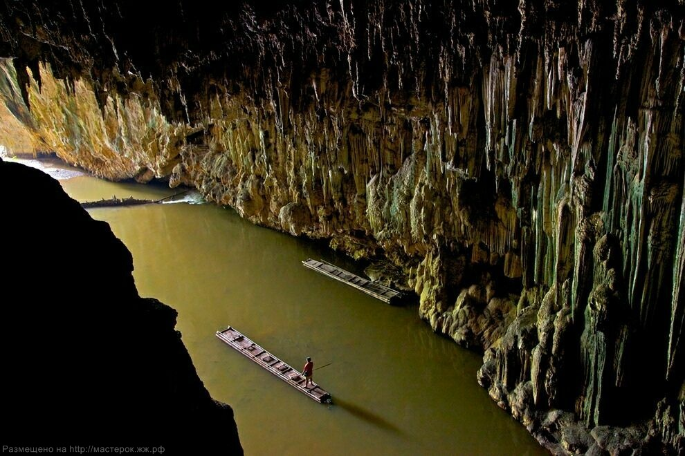***EXCLUSIVE***<br />PANG MAPHA, THAILAND - UNDATED: Shan Man Ong, standing on a bamboo raft, explores the downstream entrance of Tham Lod cave in Pang Mapha, Thailand.<br />A SUBTERREAN photographer has captured jaw-dropping pictures of cavers exploring mighty c