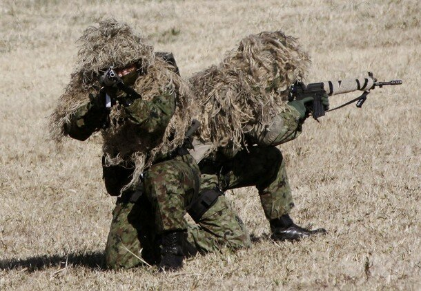 Members of Japan's Ground Self-Defense Force 1st Airborne Brigade take part in an annual new year military exercise in Narashino