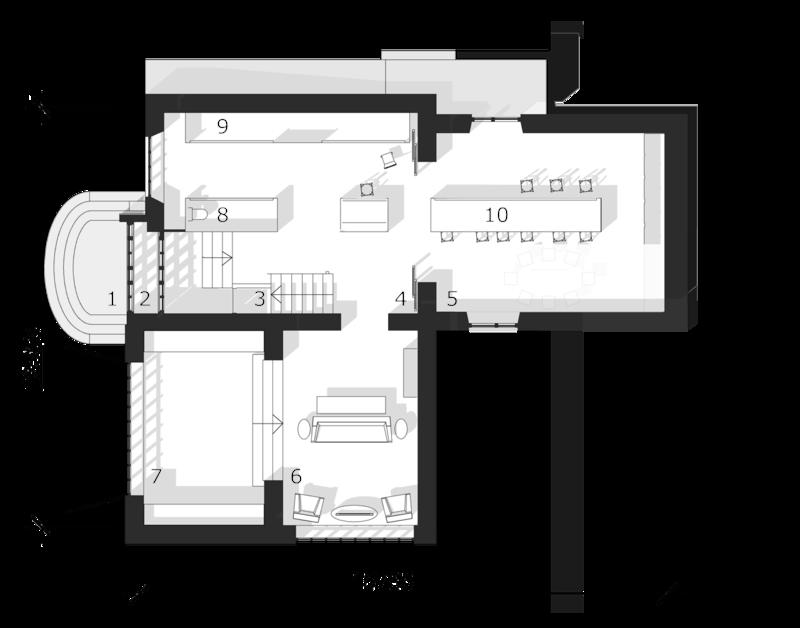 Дом в стиле швейцарского шале. План первого-цокольного этажа. Широкий гараж с мастерской, освещенной естественным светом, прихожая, лестница на второй этаж, помещение для хранения домашней утвари, ванная, столовая, кухня-бойлерная со столом в центре.