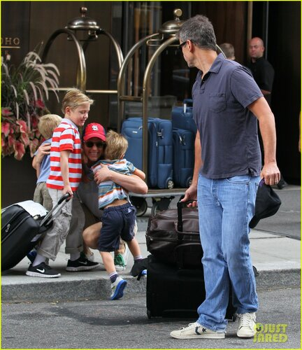 Actor Matt Bomer gets a big old hug from his three sons, Kit, and twin sons Walker and Henry while his partner Simon Halls loads up the car in New York City