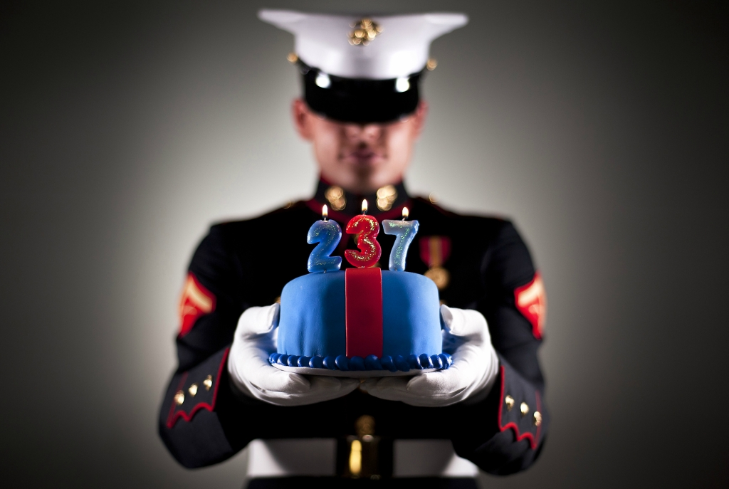 Cake holder, Lance Cpl. Donovan Lee. (U.S. Marine Corps photo by Staff Sgt. Mark Fayloga)