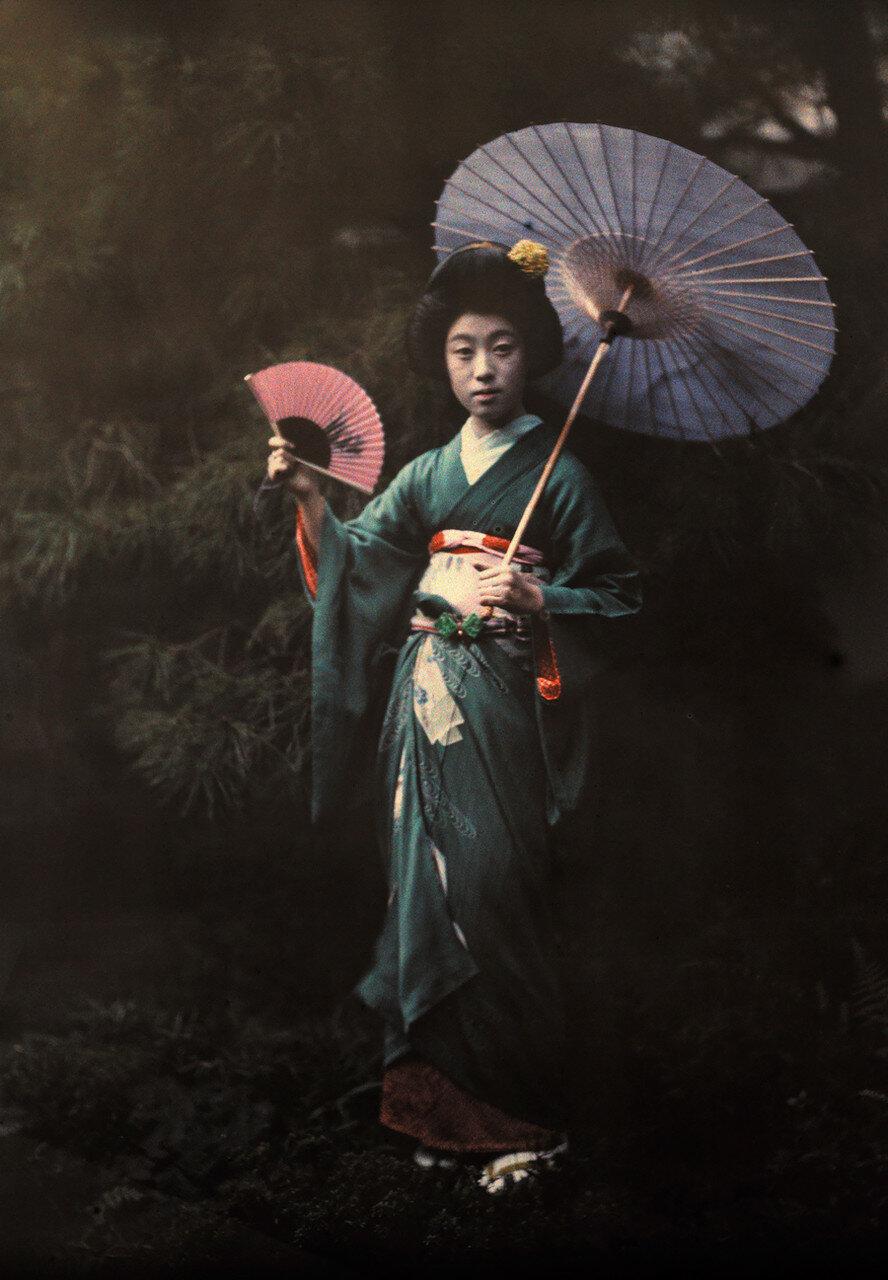 Гейша позирует в Киото