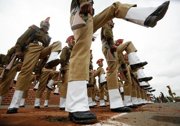 New soldiers of India's Border Security Force perform during attestation parade in Humhama