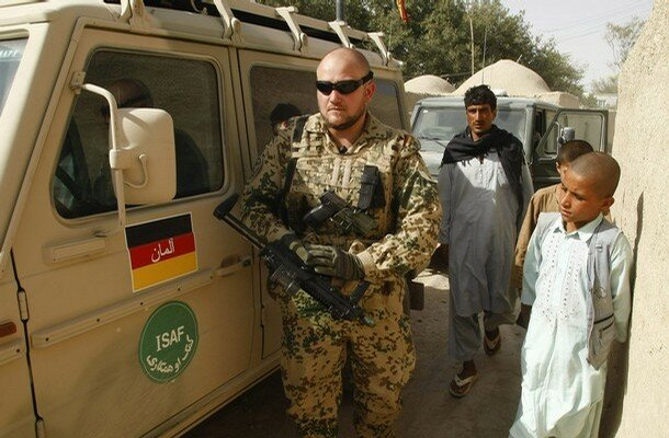 A German Bundeswehr army soldier of ISAF forces provides security during during a mission in Masar-i-Sharif