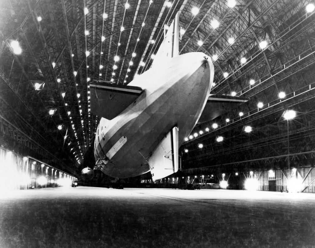 USS Macon (ZRS-5). Docked in the new airship hangar at Naval Air Station Moffett Field, Sunnyvale, California, 15 October 1933, following her flight across the United States from Lakehurst, New Jersey. A small blimp is also in the hangar.