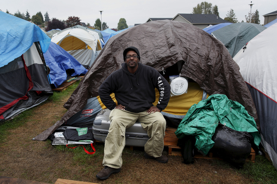 Aaron Ervin, 50, in front of his tent at SHARE/WHEEL Tent City 3 near Seattle on October 8, 2015. &l