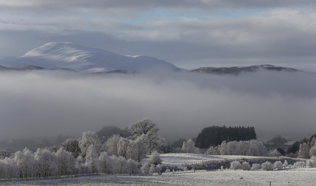 Morning mist sits in the valley of the Spey River near Kincraig Scotland Britain, February 12, 2016.