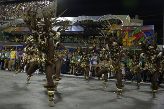 Revellers of the Mangueira samba school perform during the carnival parade at the Sambadrome in Rio