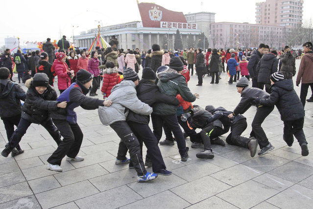 "North Korean boys play ""catch the tail"" as they gather at Kim Il Sung Square for Lunar New Year in P"