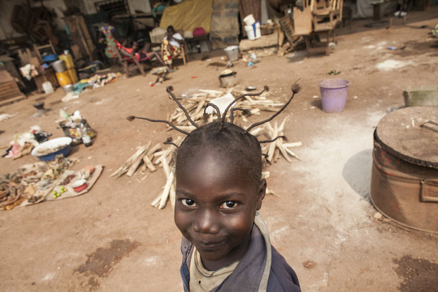 A young girl passes an informal market in M'Poko Internally Displaced Persons camp in Bangui, C