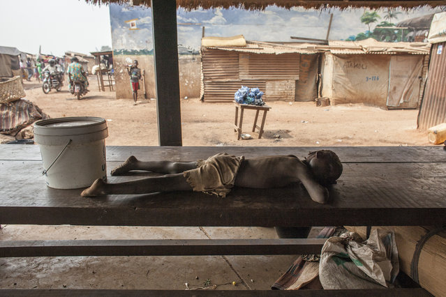 A child sleeps on a table in M'Poko Internally Displaced Persons camp in Bangui, Central Africa