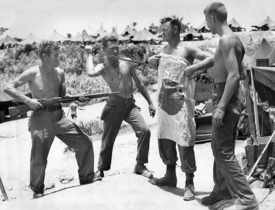 Members of the 382nd Regiment, 96th Division on Okinawa, indulge in a little horseplay with some Jap