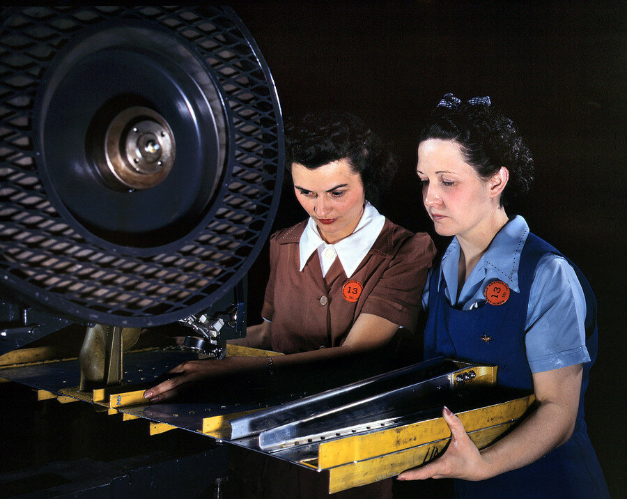 "June 1942. Inglewood, California. ""Punching rivet holes in a frame member for a B-25 bomber at North American Aviation."".jpg"