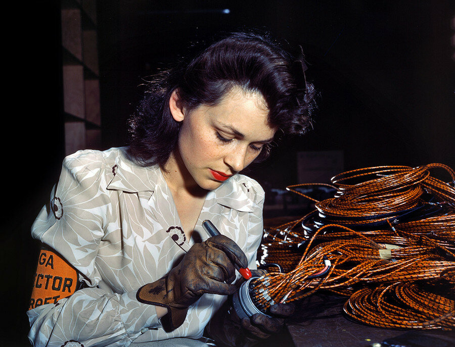 "June 1942. Lockheed Vega aircraft plant at Burbank, California. ""Hollywood missed a good bet when they overlooked this attractive aircraft worker, who is shown checking electrical sub-assemblies."".jpg"