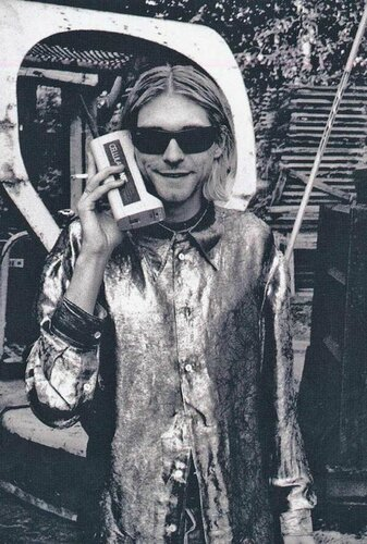Kurt-Cobain-talking-on-his-cellphone-in-the-1980s[1].jpg