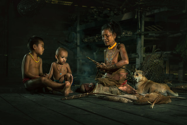 The Mentawai build their hut-like homes, known as Umas,using bamboo, wood and grass taken on July 19