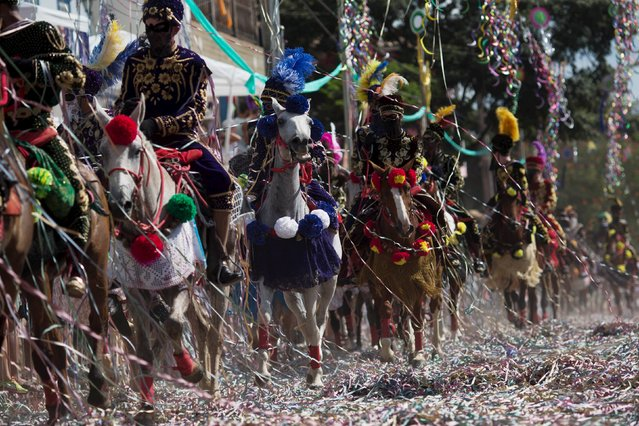Revellers participate in the traditional Carnival on horseback, a tradition dating back to the 18th