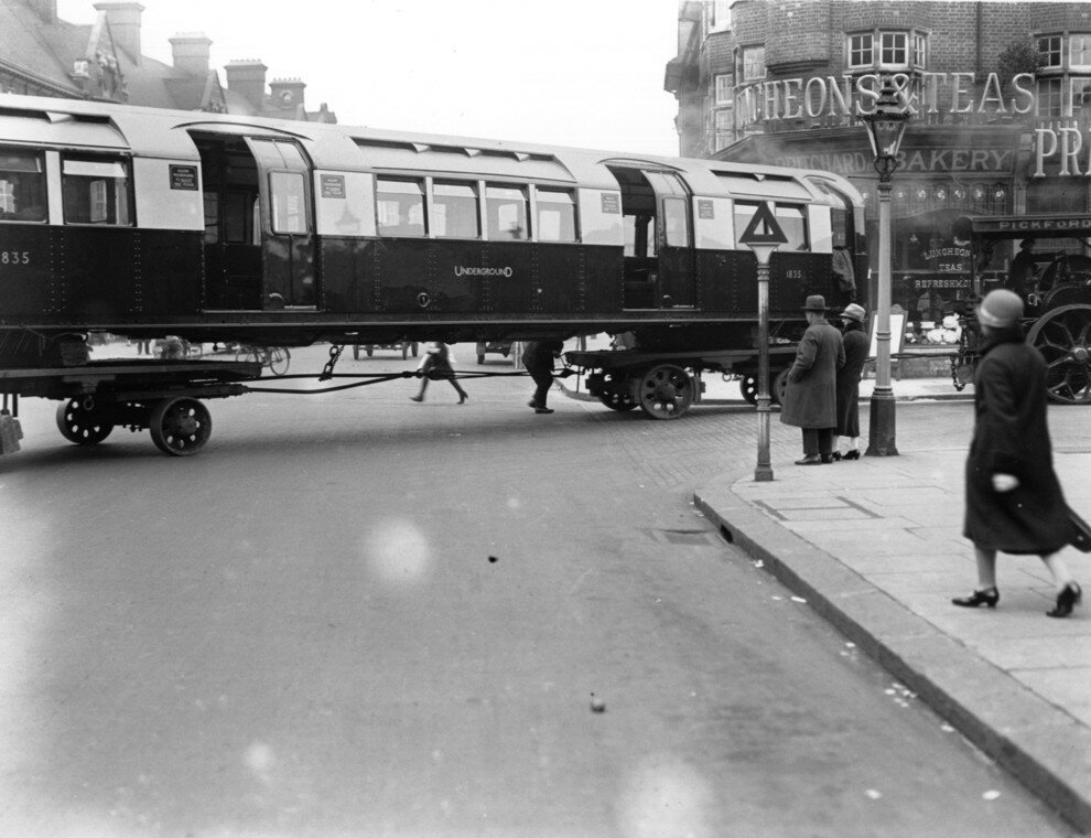 An underground train being transported on wheels through the streets of London, 1926.jpg