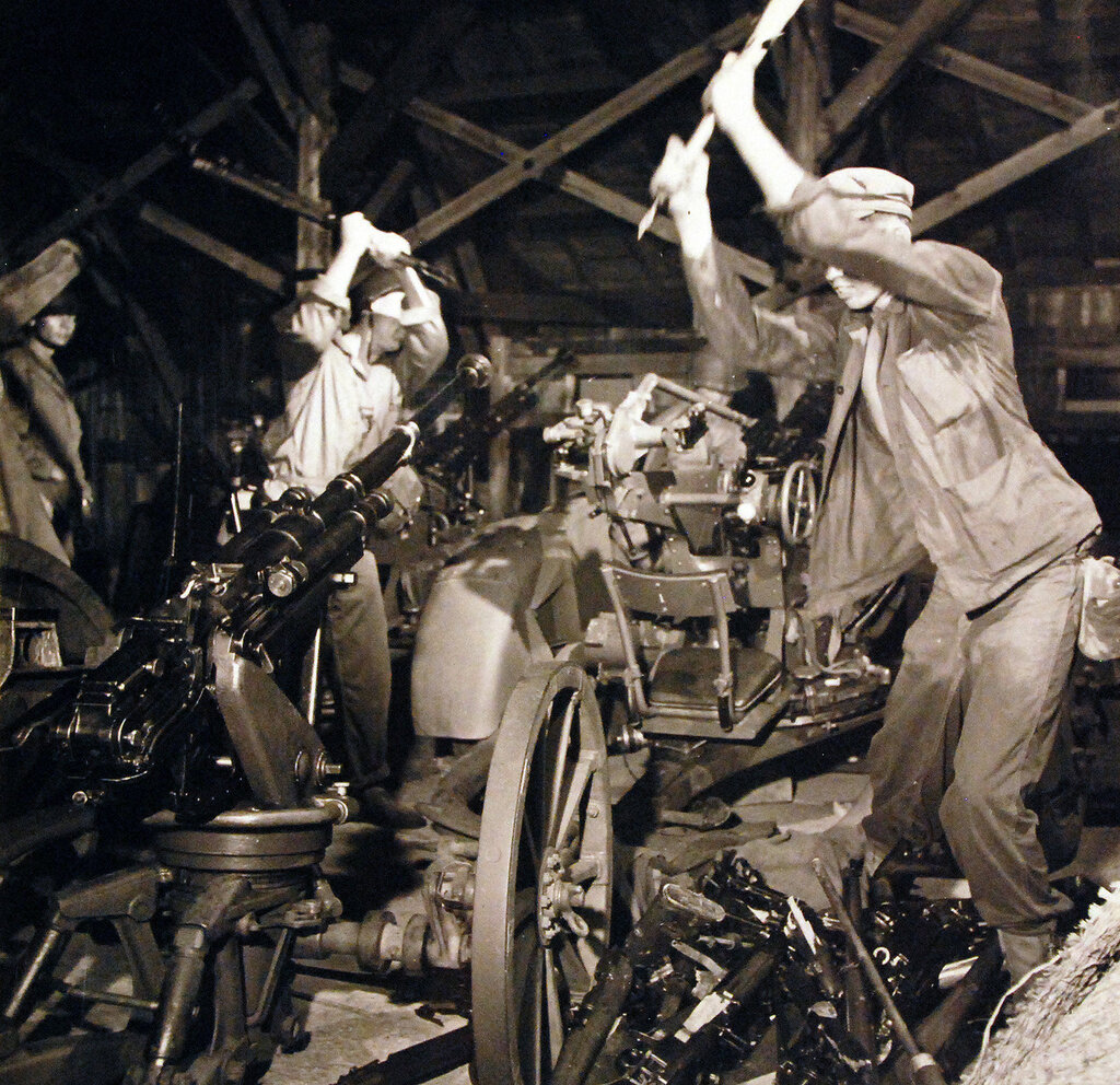 US Marines at Futtsusaki Point near Yokosuka Naval Base, destroy Japanese small arms in the first step toward disarming the Japanese. August 30, 1945