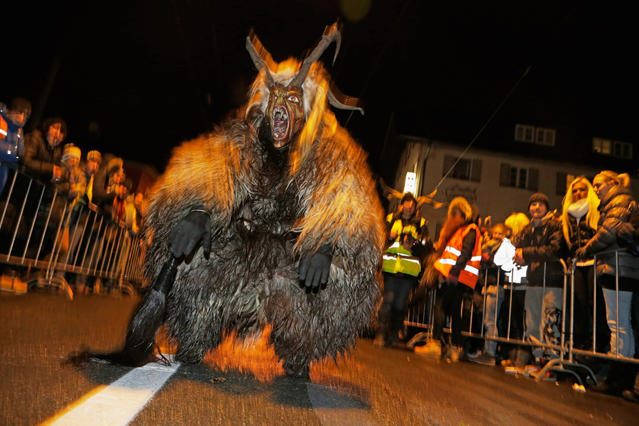 Participants dressed as Krampus search for delinquent children during a Krampus run on November 28,