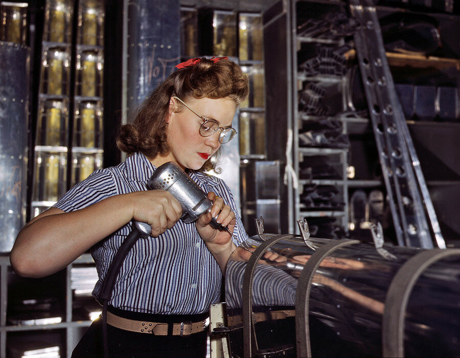 October 1942. Inglewood, California. North American Aviation drill operator in the control surface department assembling horizontal stabilizer section of an airplane.jpg