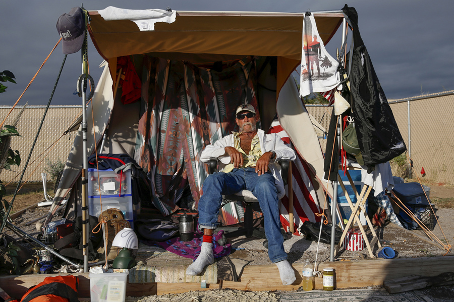 Richey Luper, from Newport Beach, California, sits outside his tent at Camp Hope in Las Cruces on Oc