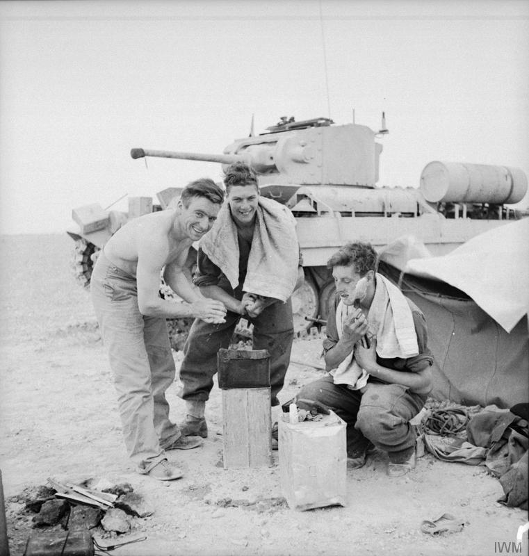 The crew of a Valentine tank have a wash and shave in the Western Desert, 27 March 1942.