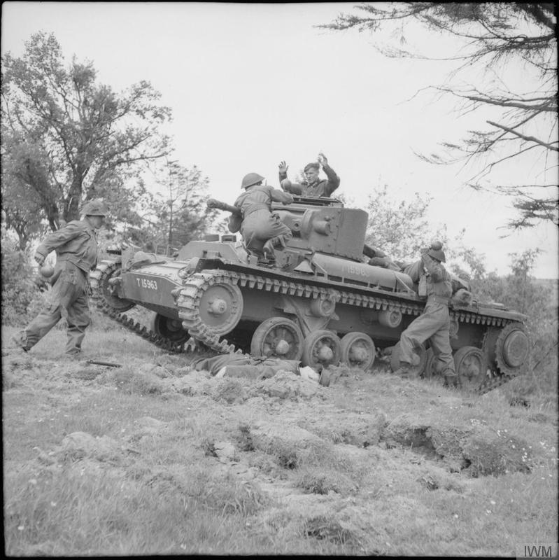 "Troops attack a ""German"" tank (in reality a Valentine) with ""sticky bombs"" during training at No. 3 GHQ Home Guard School at Onibury near Craven Arms in Shropshire, 20 May 1943."