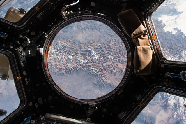 The Earth view from the cupola onboard the International Space Station. NASA astronaut Scott Kelly t