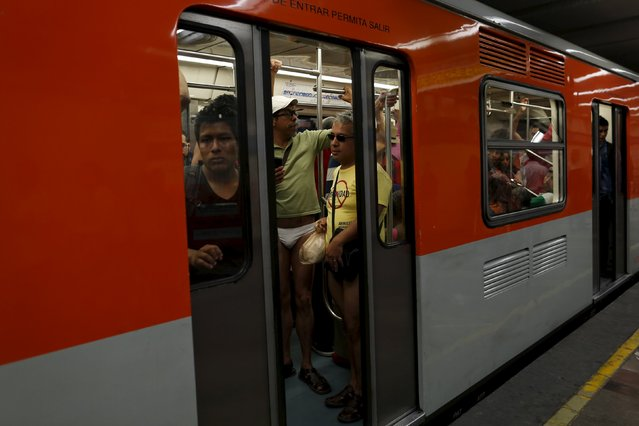 "Passengers not wearing pants stand is a subway train during the ""No Pants Subway Ride"" in Mexico Cit"
