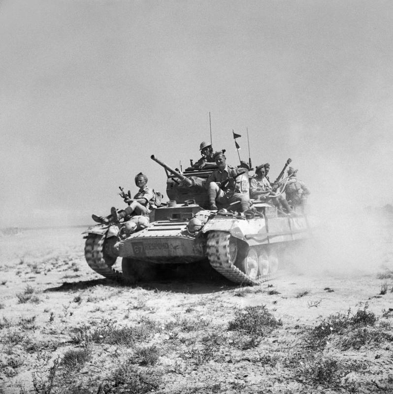 Valentine tank carrying infantry of the Black Watch, March 1943.