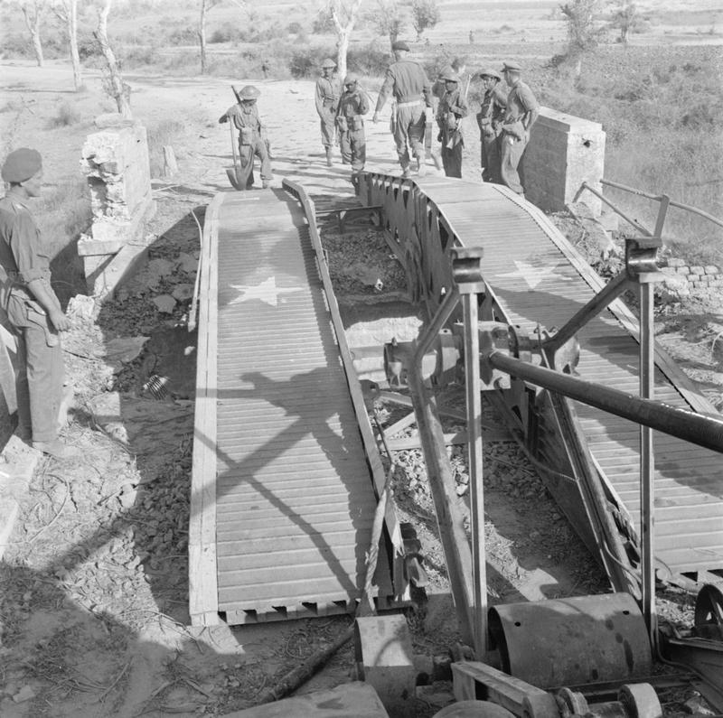 A scissors bridge laid down over a damaged road bridge near Meiktila by a Valentine bridgelayer of the 3rd Independent Bridge Building Company, Royal Armoured Corps, 28 March 1945