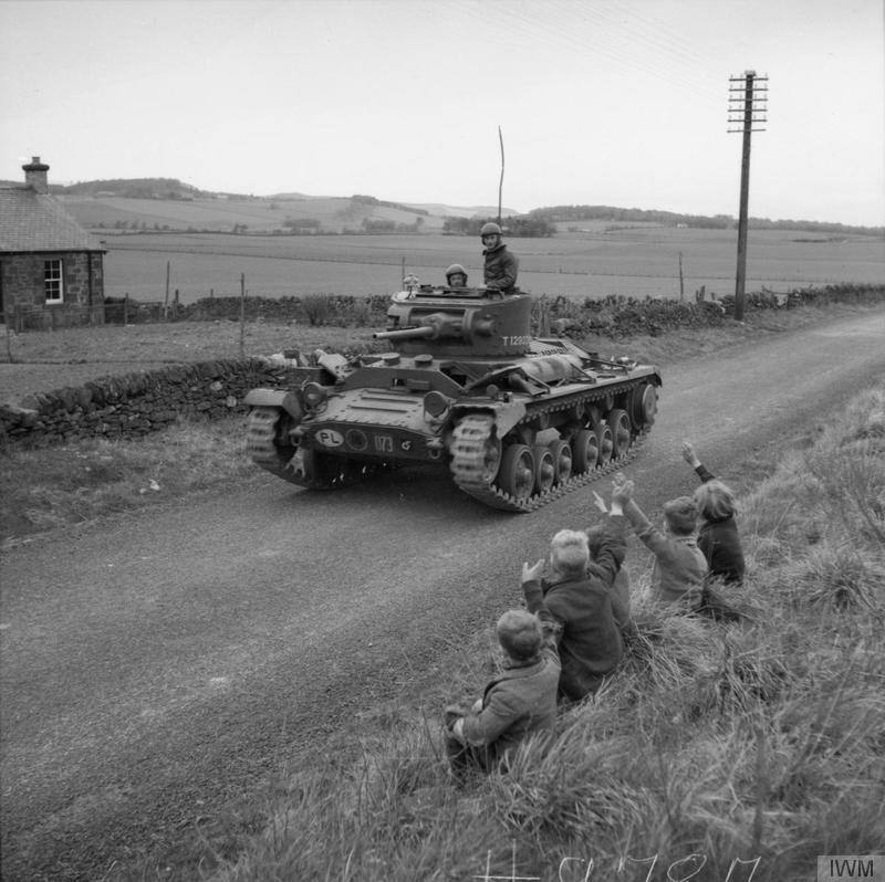 "Children waving at a Valentine tank of the 2nd Battalion, 1st Tank Regiment (1st Polish Corps) on the move against the ""invaders"" during a mock invasion exercise in Perthshire"