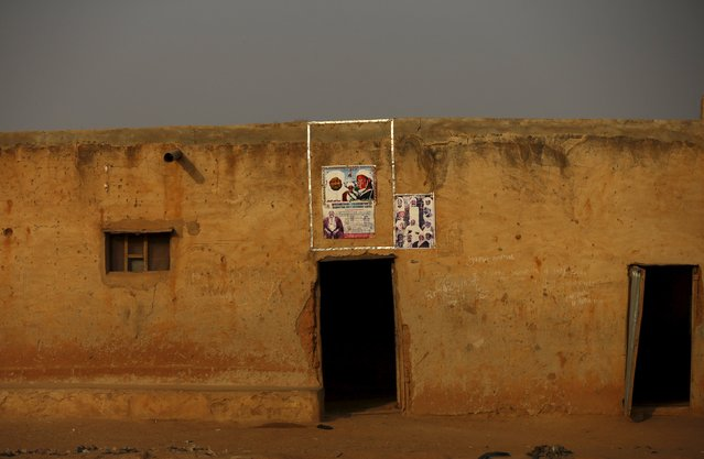 Posters of Islamic leaders are seen above the doorway of a house in Zaria, Kaduna state, Nigeria, Fe