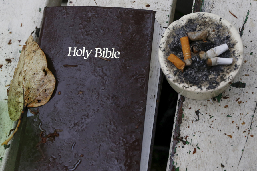 A Bible and ashtray filled with cigarettes at SHARE/WHEEL Tent City 4 outside Seattle, on October 9,