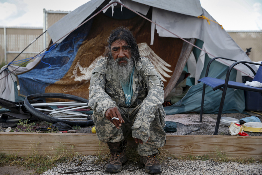 Daniel J. Wabsey, a 58-year-old war veteran, sits outside his tent at Camp Hope in Las Cruces, New M