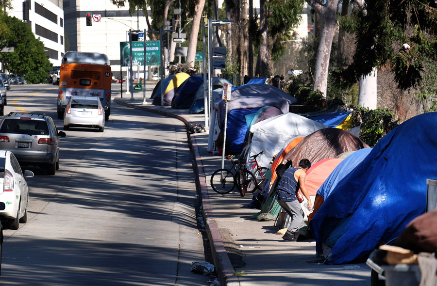 Tents from a homeless encampment line a street in downtown Los Angeles on January 26, 2016. Some 7,0