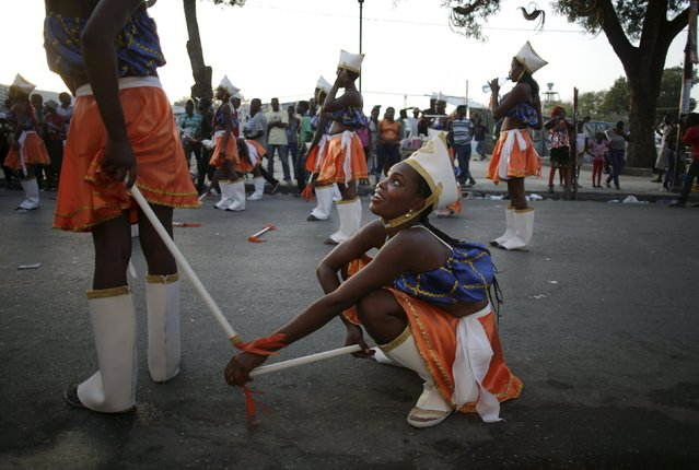 Revellers take a break during the Carnival 2016 parade in Port-au-Prince, Haiti, February 8, 2016. (