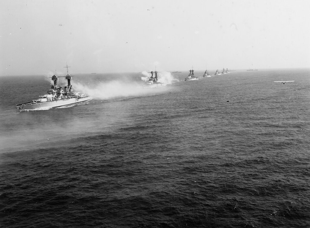 Battleships of the US fleet salute while steaming in line ahead, during the review off New York on 31 May 1934