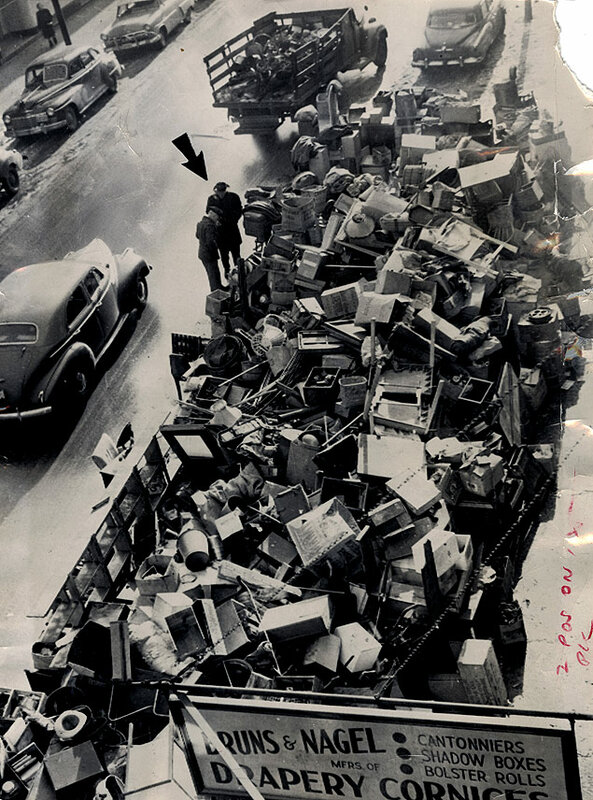 Benjamin Sanchez, a Chicago second-hand dealer evicted from his store, sells his piled up merchandise on the city street