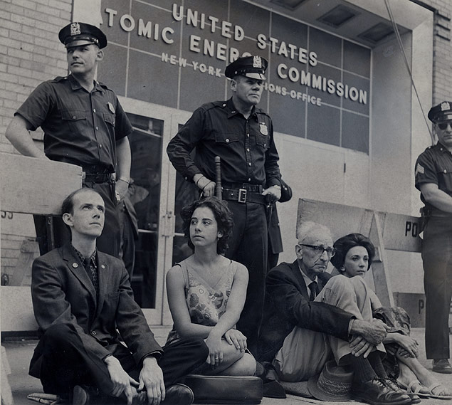 Four protesters staging a sit-down in front of the Atomic Energy Commission headquarters