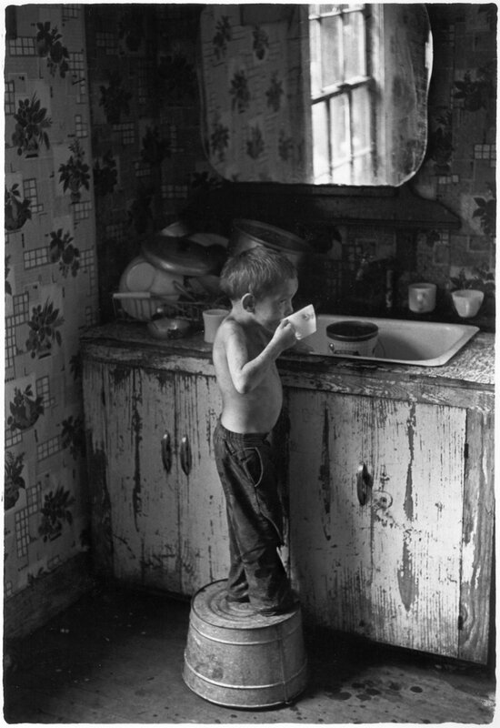 Small boy drinking water in his home in Kentucky, 1964