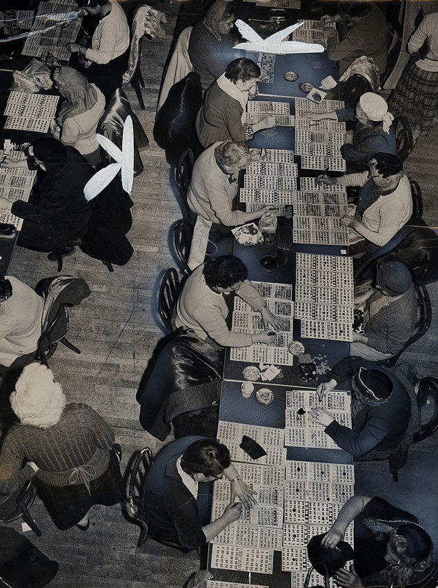 Tables full of cards are overseen by hundreds of bingo players in games sponsored by the Bronx Church of the Holy Resurrection.jpg