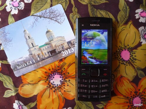Nokia X2-02 (фото на календарике - А.Ланцевицкого)
